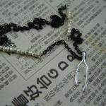 Sterling silver wishbone charm on oxidized black chain with Thai silver nugget accents.  SOLD